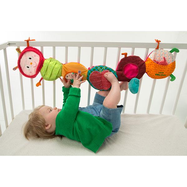 Jouet de lit bébé panneau découvertes juliette Lilliputiens