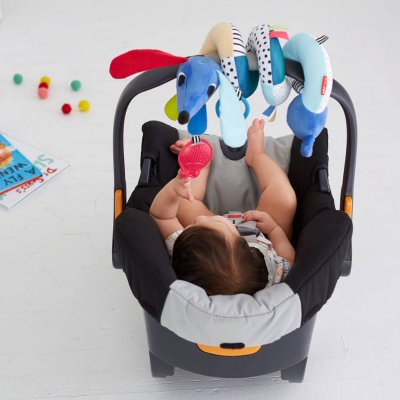Jouet d'éveil bébé barre d'activité pour poussette village Skip hop