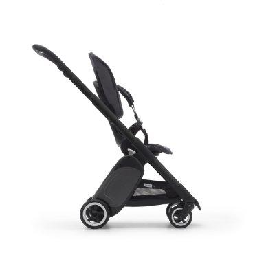 Poussette 4 roues ant noir avec style set noir et capote rouge néon Bugaboo